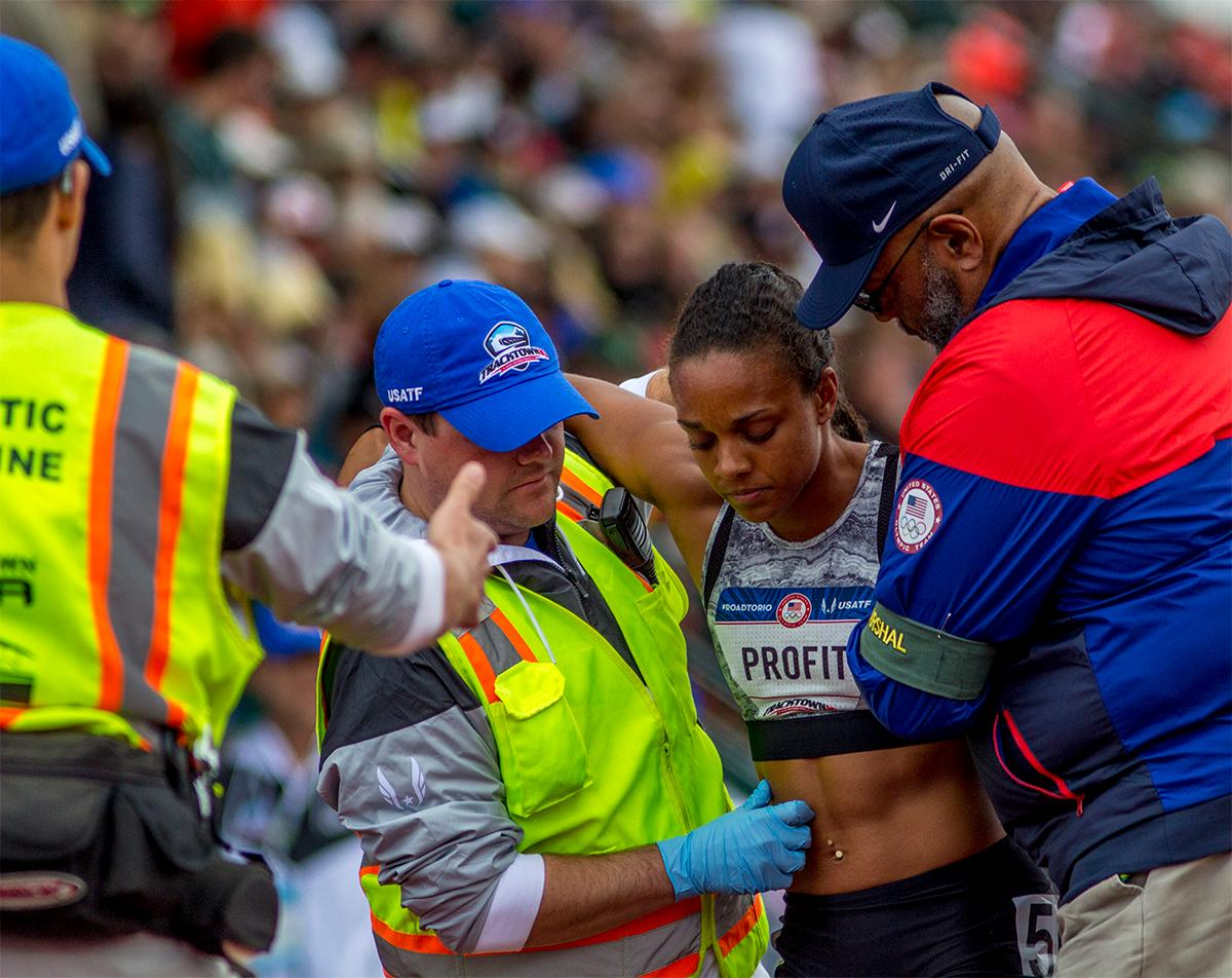 Diana Profit is helped off the track by paramedics after the 800 portion of the heptathlon. Profit finished second in the 800 with a time of 2:14.63 and seventh overall. Photo by August Frank, Oregon News Lab