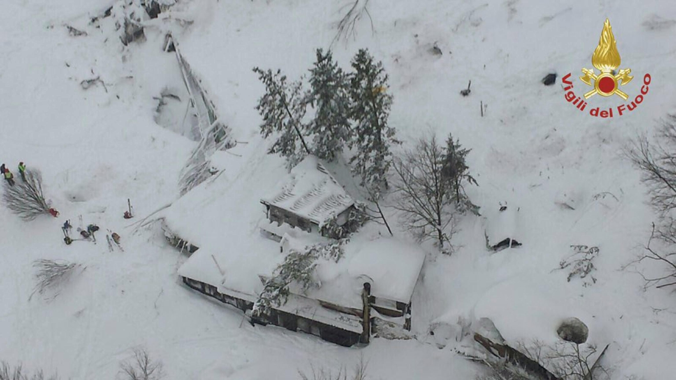 An aerial view of the Rigopiano Hotel hit by an avalanche in Farindola, Italy, early Thursday, Jan. 19, 2017. A hotel in the mountainous region hit again by quakes has been covered by an avalanche, with reports of dead. Italian media say the avalanche covered the three-story hotel in the central region of Abruzzo, on Wednesday evening. (Italian Firefighters via AP)