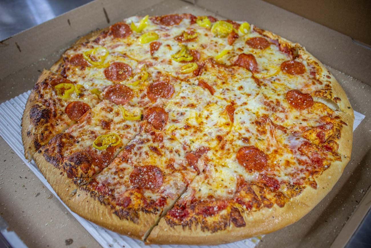 Keep up with specials such as a limited cauliflower-crust pizza on Facebook (@poseidonspizzacompany). The restaurant focuses solely on carryout and delivery, and you can visit PoseidonsPizzaCompany.com to place an order conveniently online. Free delivery is offered for customers within a few miles of the locations. / Image courtesy of Poseidon's Pizza Company // Published: 7.8.20