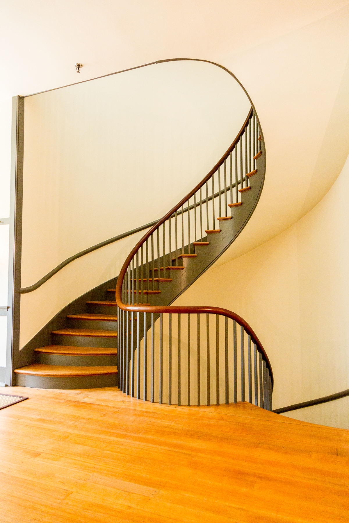 Micajah Burnett's winding three story double spiral staircase is one of the most beautiful feat's of woodworking we've ever seen. / Image: Daniel Smyth