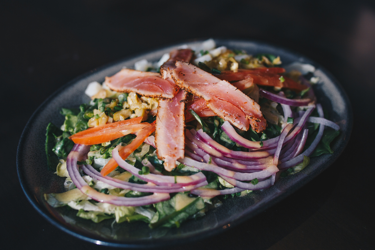 Tuna Nicoise Salad: ahi tuna, spinach and iceberg blend, olives, new potatoes, French beans, red onions, grape tomatoes, and a lemon vinaigrette / Image: Catherine Viox // Published: 1.14.19