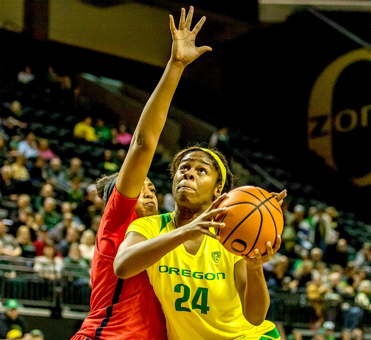 The Duck's Ruthy Hebard (#24) makes a run for the basket. The Duck's Sabrina Ionescu (#20) is introduced at the start of the game against the Ole Miss Rebels. The Oregon Ducks womens basketball team defeated the Ole Miss Rebels 90-46 on Sunday at Matthew Knight Arena. Sabrina Ionescu tied the NCAA record for triple-doubles, finishing the game with 21 points, 14 assists, and 11 rebounds. Ruthy Hebard added 16 points, Satou Sabally added 12, and both Lexi Bando and Maite Cazorla scored 10 each. The Ducks will next face off against Texas A&M on Thursday Dec. 21 and Hawaii on Friday Dec. 22 in Las Vegas for Duel in the Desert before the start of Pac-12 games. Photo by August Frank, Oregon News Lab