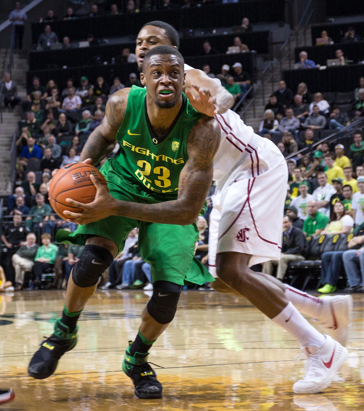 Oregon Ducks Elgin Cook (#23) drives toward the basket during the game against the Washington State Cougars. Cook led the Ducks with 24 points adding to their 76-62 win over the Cougars. Kianna Cabuco, Oregon News Lab