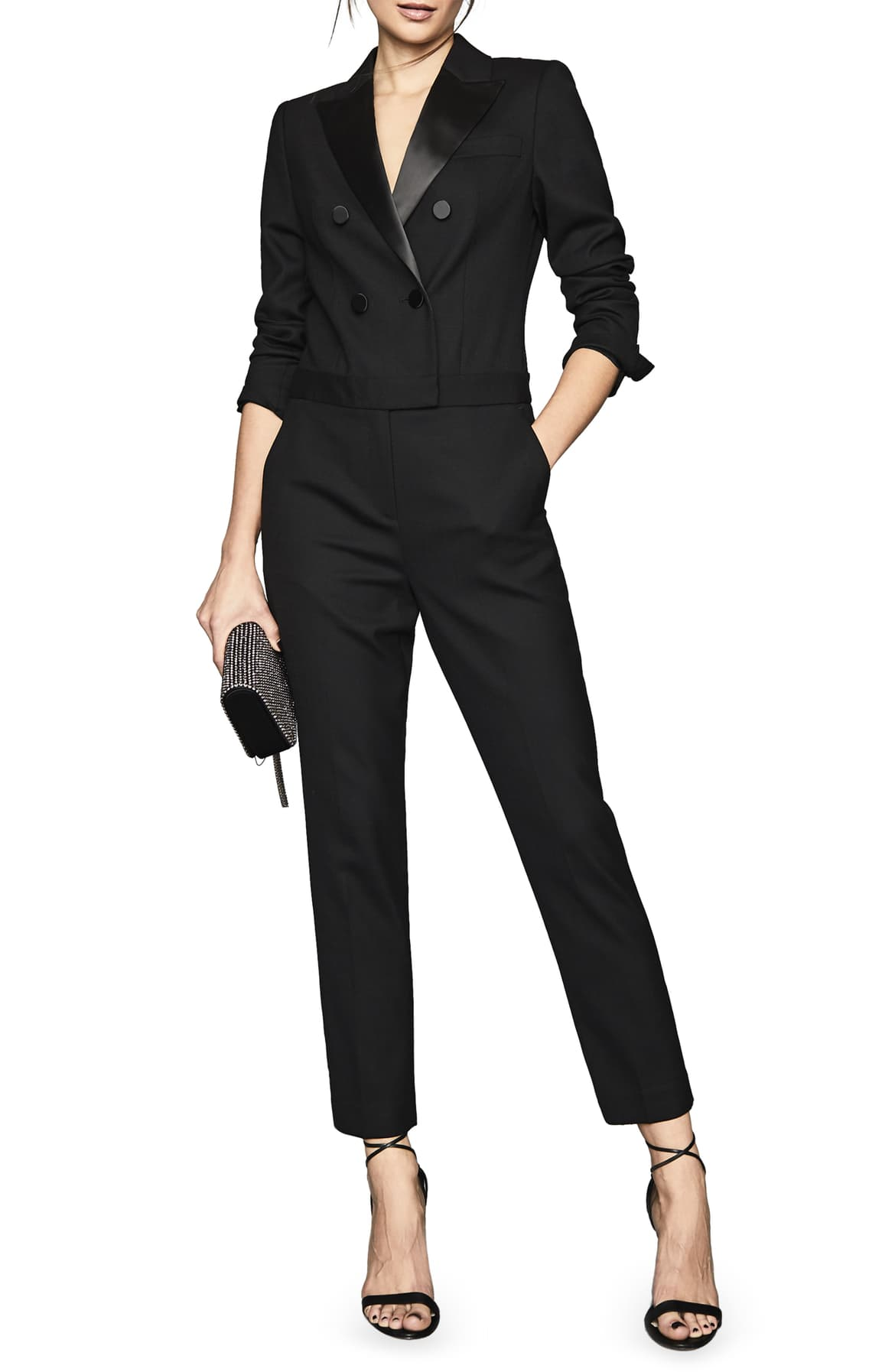 "<a  href=""https://shop.nordstrom.com/s/reiss-mariana-long-sleeve-tuxedo-jumpsuit/5414718/full?origin=keywordsearch-personalizedsort&breadcrumb=Home%2FAll%20Results&color=black"" target=""_blank"" title=""https://shop.nordstrom.com/s/reiss-mariana-long-sleeve-tuxedo-jumpsuit/5414718/full?origin=keywordsearch-personalizedsort&breadcrumb=Home%2FAll%20Results&color=black"">Mariana Long Sleeve Tuxedo Jumpsuit - $620</a>. From cozy to gold hued to tailored, Nordstrom has the hottest trends for getting glam this holiday season! (Credit: Nordstrom)"