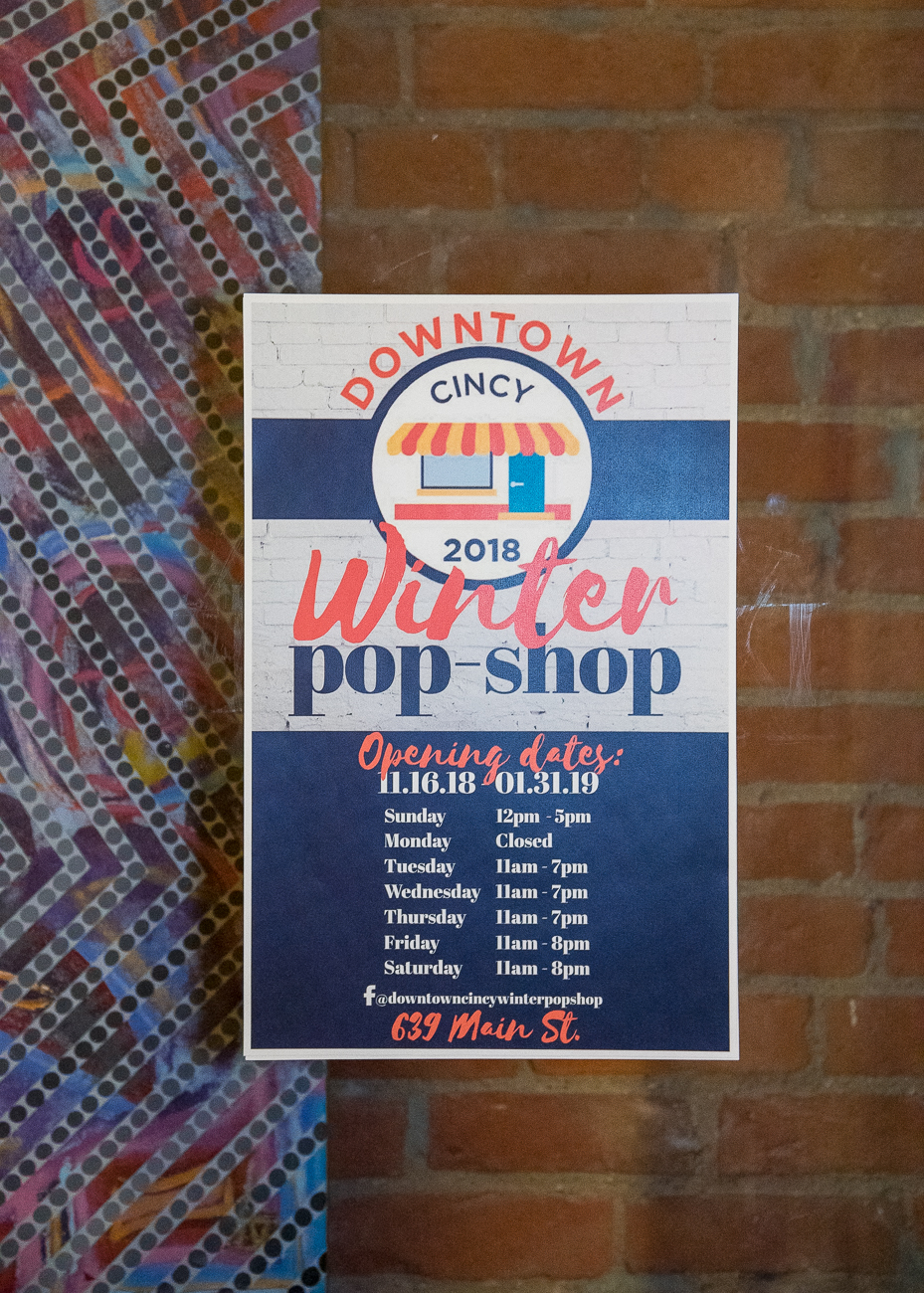 The Pop-Shop is the result of a collaboration between Downtown Cincinnati Inc. and the City of Cincinnati. Working with property owners in the city, the program places artists, makers, and business owners together to activate spaces in a different way. Earlier this year, DCI put out a call to entrepreneurs and many applied to be featured in this year's shop. Of the applicants, four business-savvy women were chosen to head up the 639 Main Street storefront. / Image: Phil Armstrong, Cincinnati Refined // Published: 12.4.18