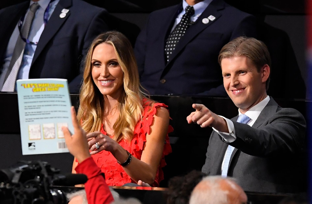 Donald Trump's son Eric Trump, right and wife Lara interact with the crowd during the second day of the Republican National Convention in Cleveland, Tuesday, July 19, 2016. (AP Photo/Mark J. Terrill)