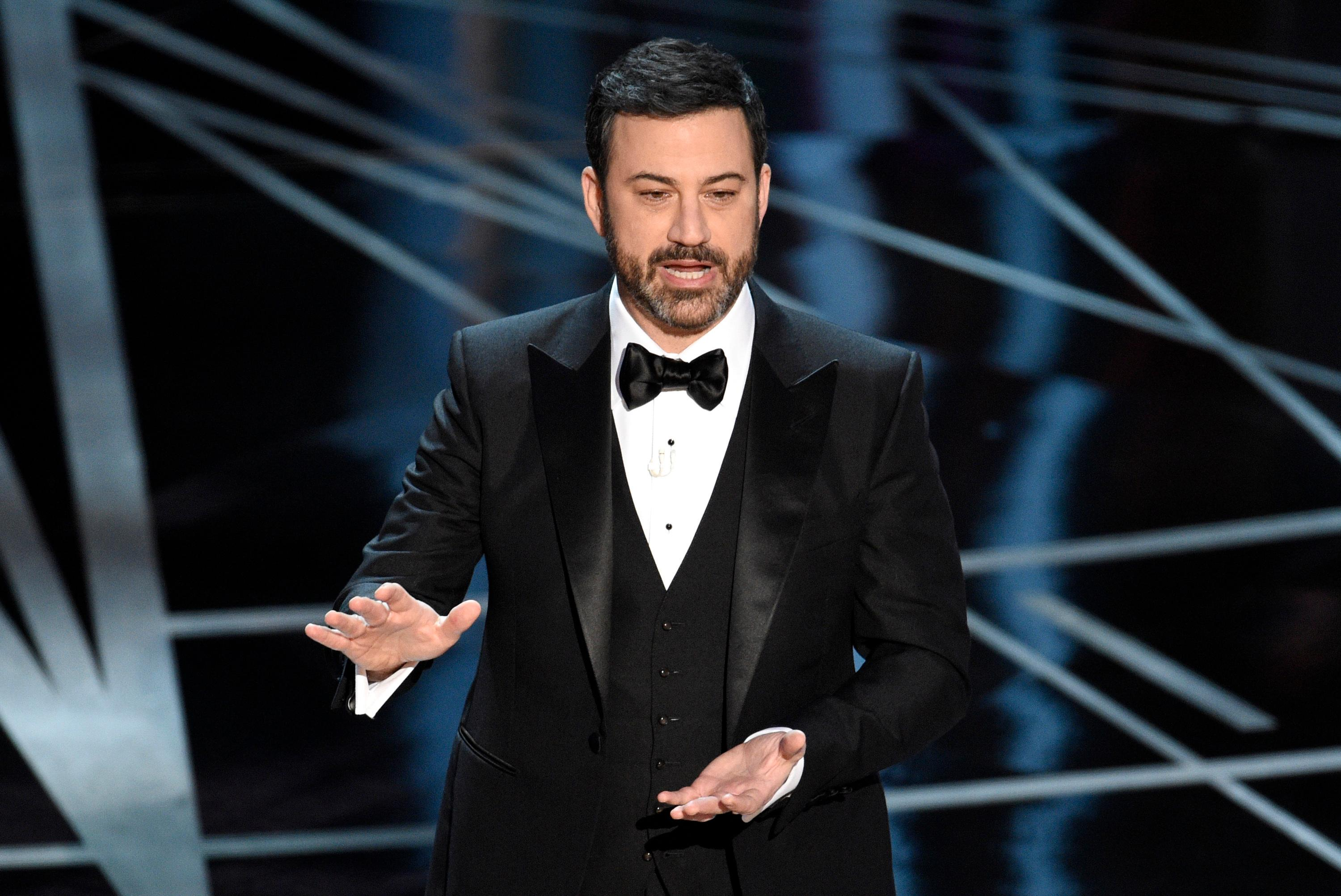 FILE - In this Feb. 26, 2017 file photo, host Jimmy Kimmel appears at the Oscars in Los Angeles. Late-night comics decr