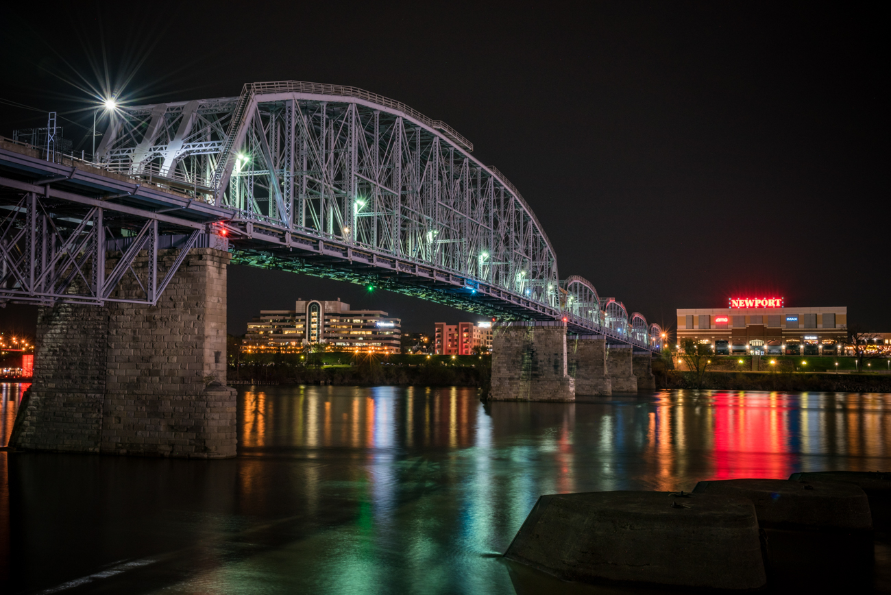 The Newport Southbank Bridge, better known as the Purple People Bridge, is a pedestrian-only bridge connecting the Cincinnati waterfront (at Sawyer Point) to Newport on the Levee. What many people don't know is that the bridge dates back to 1872 and has seen a variety of uses, from railroad to streetcars and more. / Image: Phil Armstrong, Cincinnati Refined // Published: 5.17.17