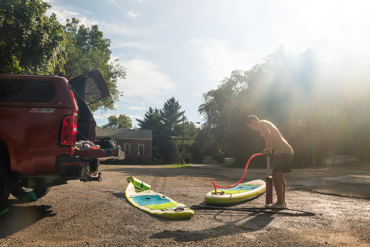John McIntosh inflates a paddleboard prior to our paddle.  Inflatable gear is easy to store and convenient for people who don't have trailers or roof rack set ups. / Image: Allen Meyer // Published: 9.7.18