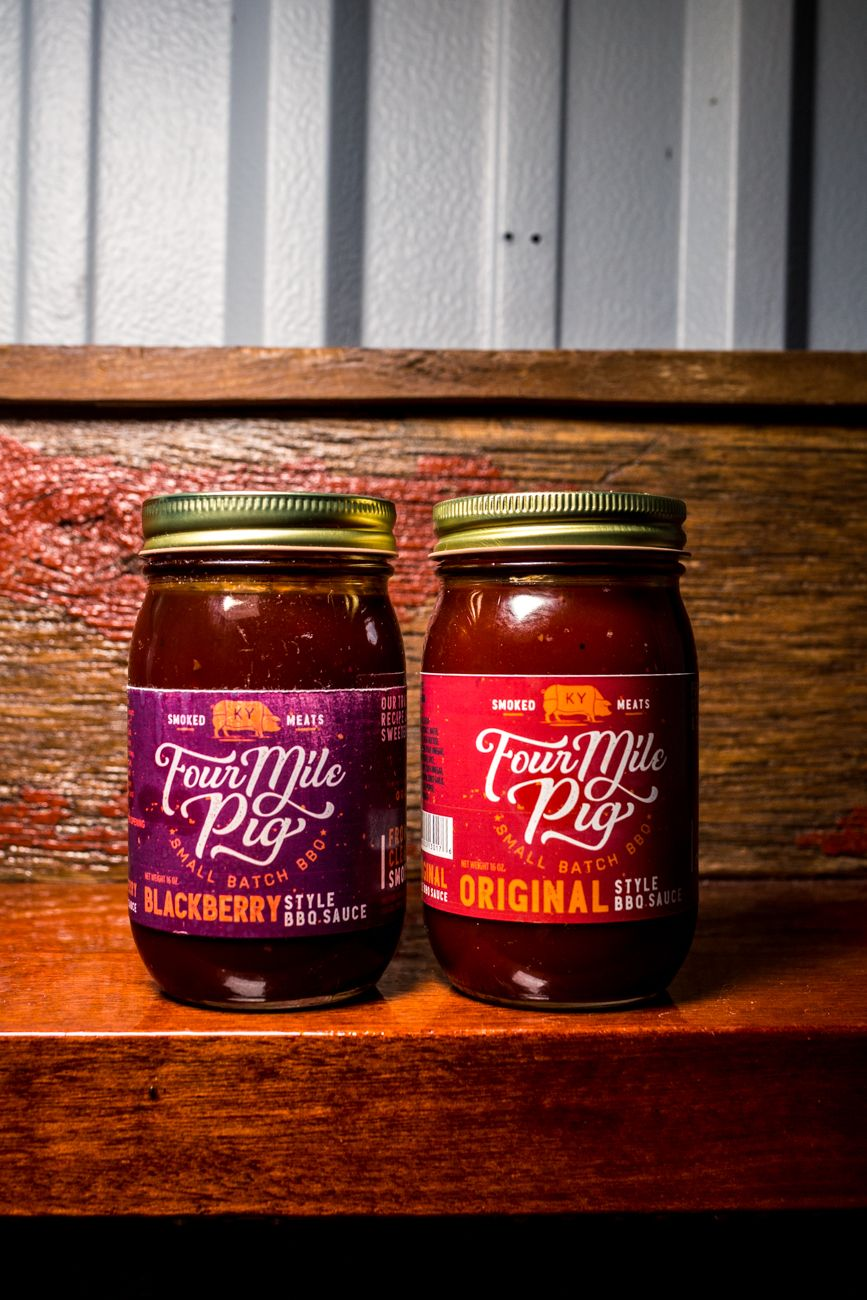 House made barbecue sauces to take home from Four Mile Pig / Image: Catherine Viox // Published: 8.28.20