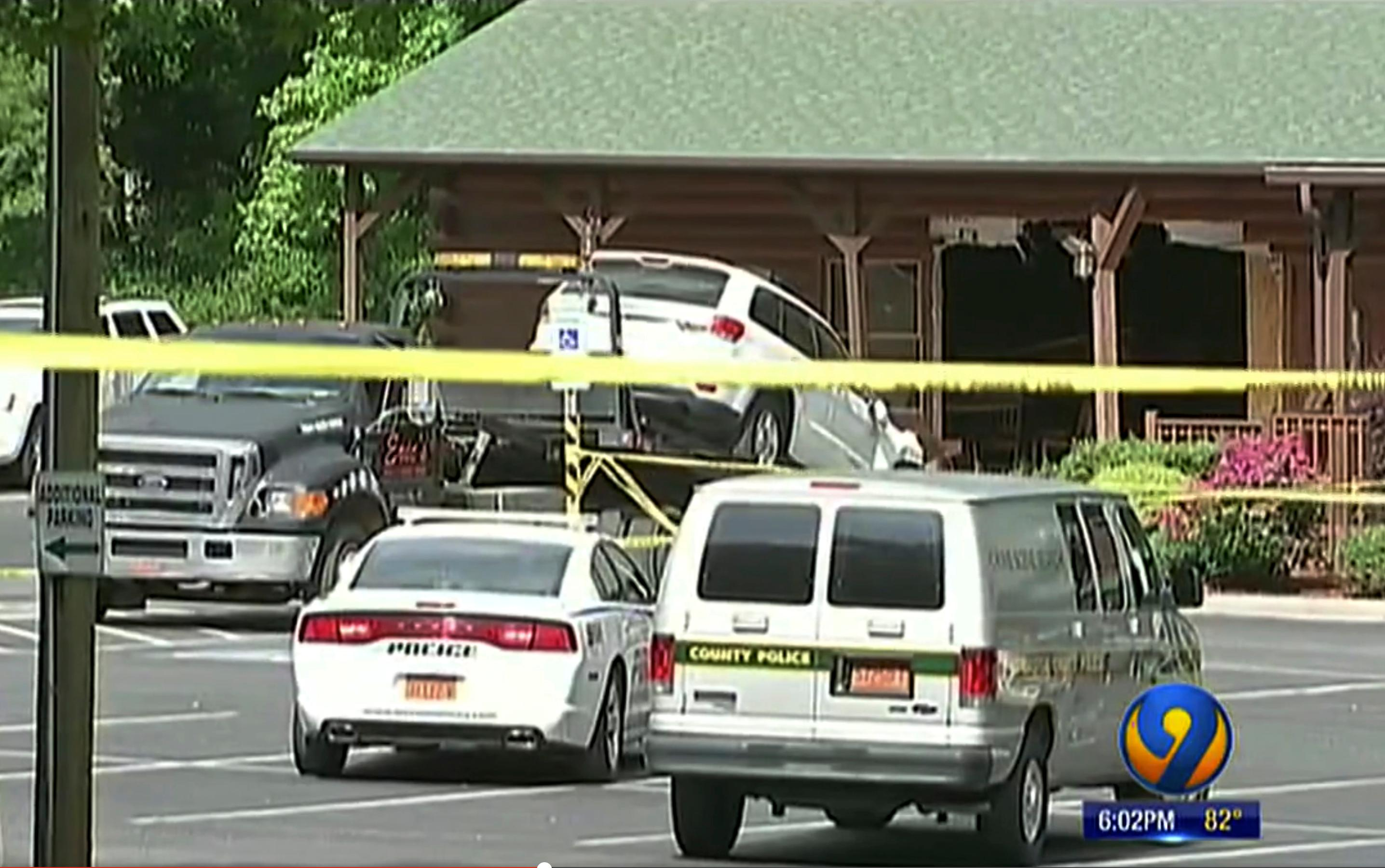This frame grab from video provided by WSOC-TV 9 in Charlotte, N.C., shows an SUV driven by Roger Self being towed from the scene after Self intentionally rammed his vehicle into a restaurant busy with a lunchtime crowd, Sunday, May 20, 2018, killing his daughter and another person and injuring several others, in Bessemer City, N.C., according to authorities. (Courtesy of WSOC-TV 9 via AP)