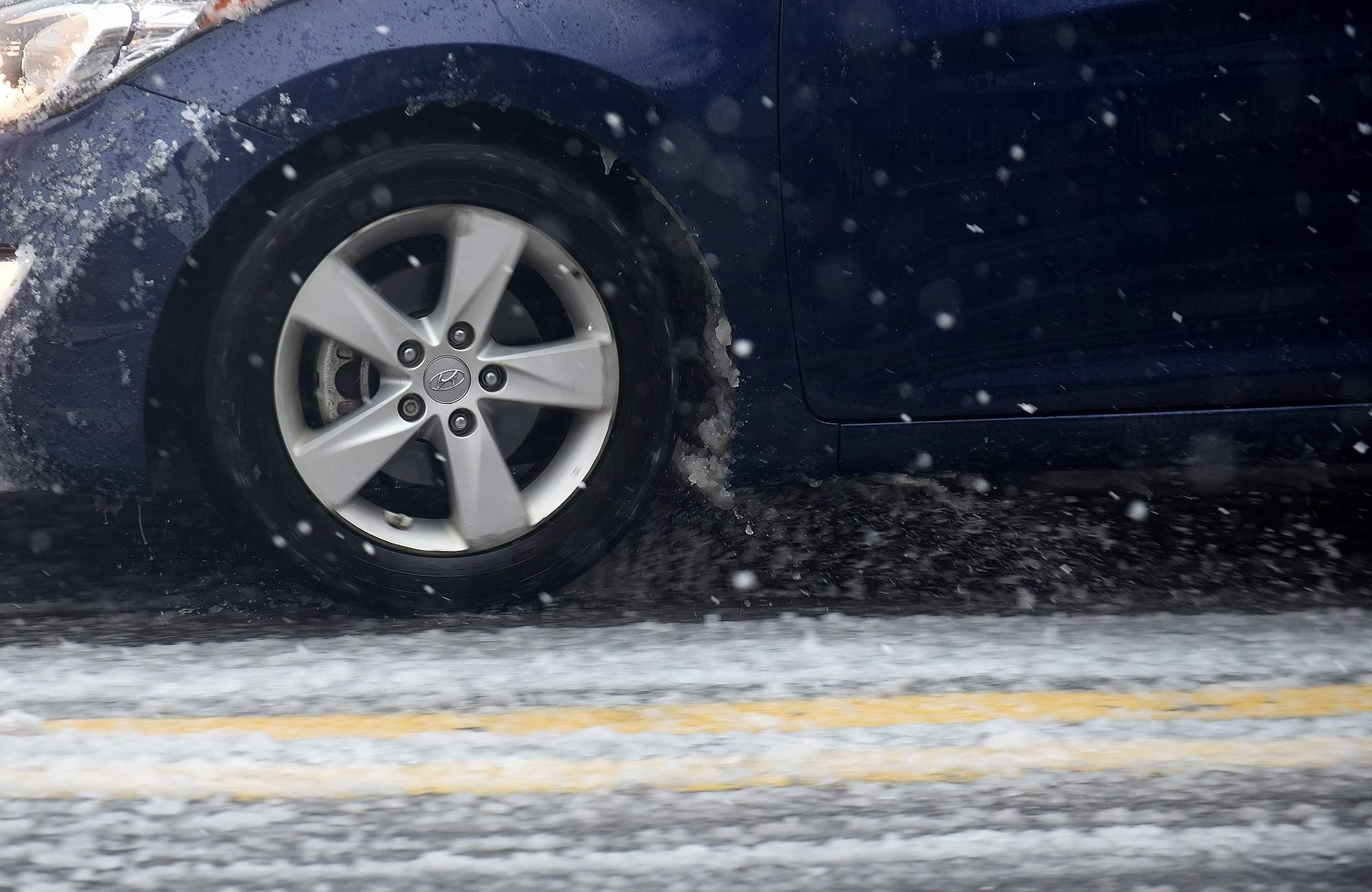 A car drives through slushy conditions on High Street in Burlington City during a snowstorm on Wednesday, March 7, 2018. [CARL KOSOLA / STAFF PHOTOJOURNALIST]