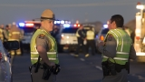 Passing driver kills man attacking Arizona trooper on road