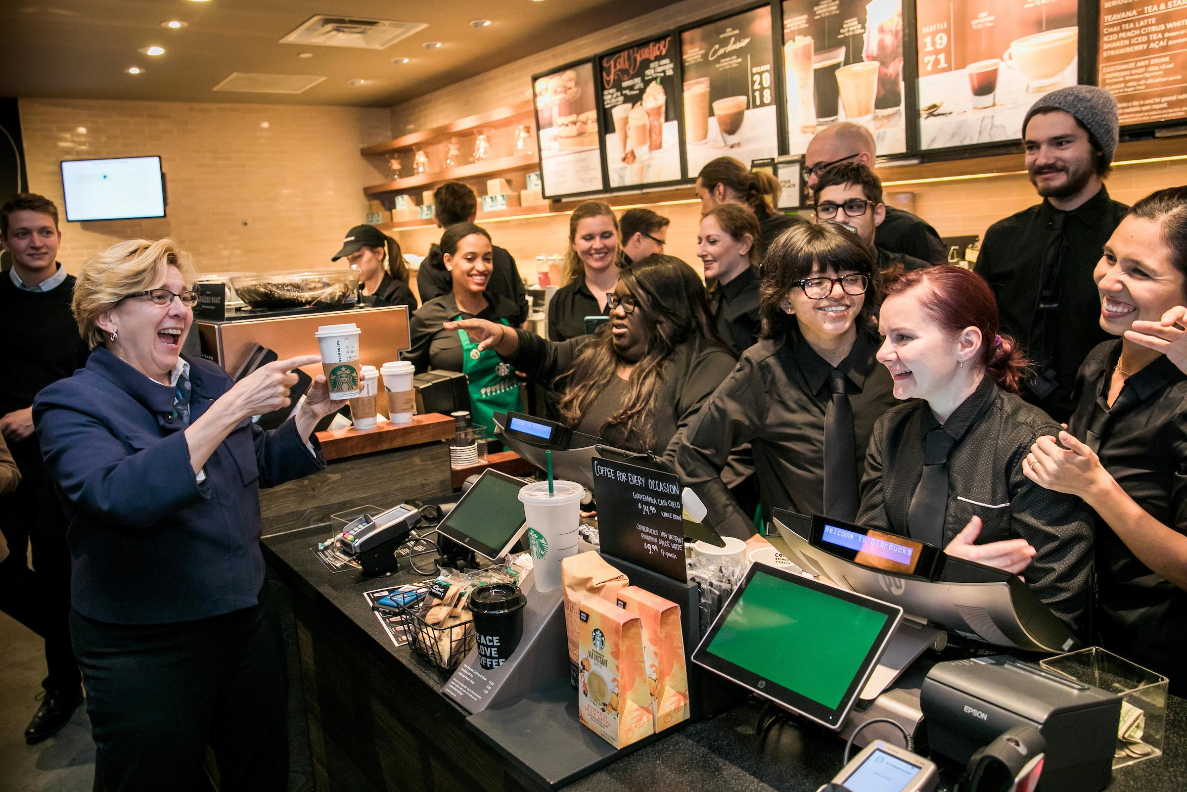 Roberta J. Cordano, President of Gallaudet University, stopped by for a cup of coffee. Many of the employees are students or alumni of Gallaudet.{ }(Image: Joshua Trujillo, Starbucks)