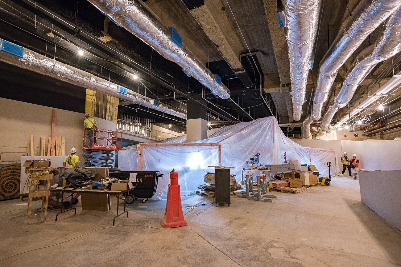 The Duke Energy Holiday Trains are being installed in one of the lower floors of the building. Currently, the famous 72-year-old model sits within a temporary safety tent to prevent it from being damaged by any leakage that may occur from the ceiling above as crews work to waterproof it. They will be on display again in 2018. / Image: Phil Armstrong, Cincinnati Refined // Published: 9.1.17