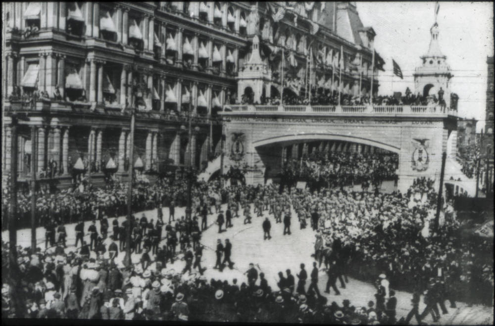 A temporary arch spans the width of Fifth Street on Government Square as a massive parade marches east. The parade was held by the Grand Army of the Republic (GAR) in 1898. The GAR was an organization made up of Union veterans of the Civil War. The last member of the GAR died in 1956 and the organization was formally disbanded thereafter. / From the collection of the Public Library of Cincinnati and Hamilton County / Image courtesy of the Public Library of Cincinnati and Hamilton County // Published: 9.27.18
