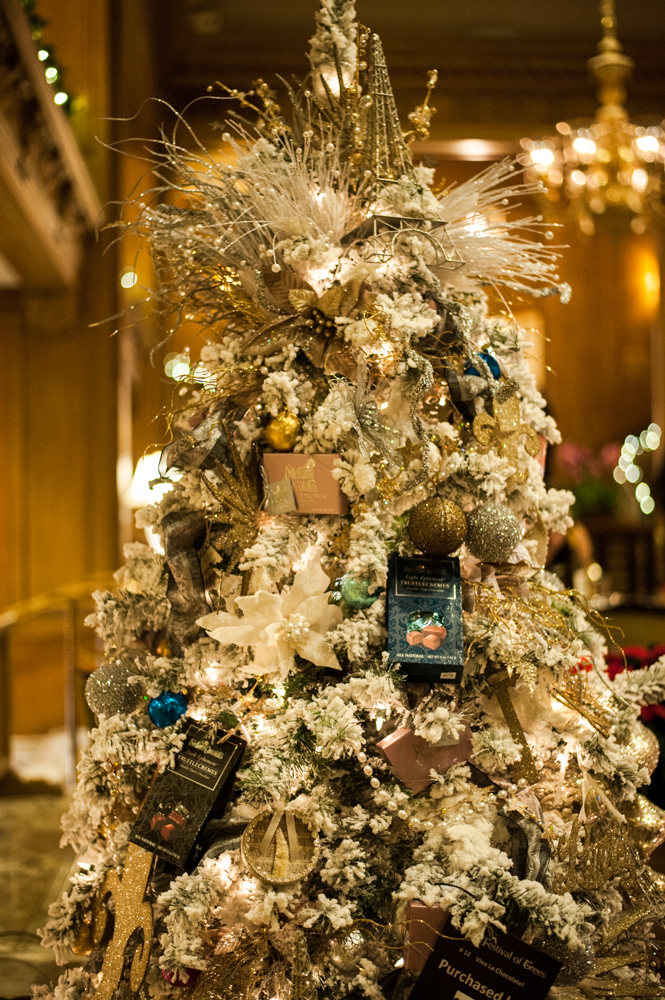 <p>Viva la Chocolate - 7.5 feet tall, filled with Dilettante Chocolates delicacies! Located in the Fairmont Olympic Hotel in downtown Seattle, the annual Festival of Trees has officially kicked off this holiday season. Patrons can view the trees on display through December 2, 2018 - or bid on them for their home/office. Proceeds benefit Seattle Children's Hospital. (Image: Elizabeth Crook / Seattle Refined)</p>