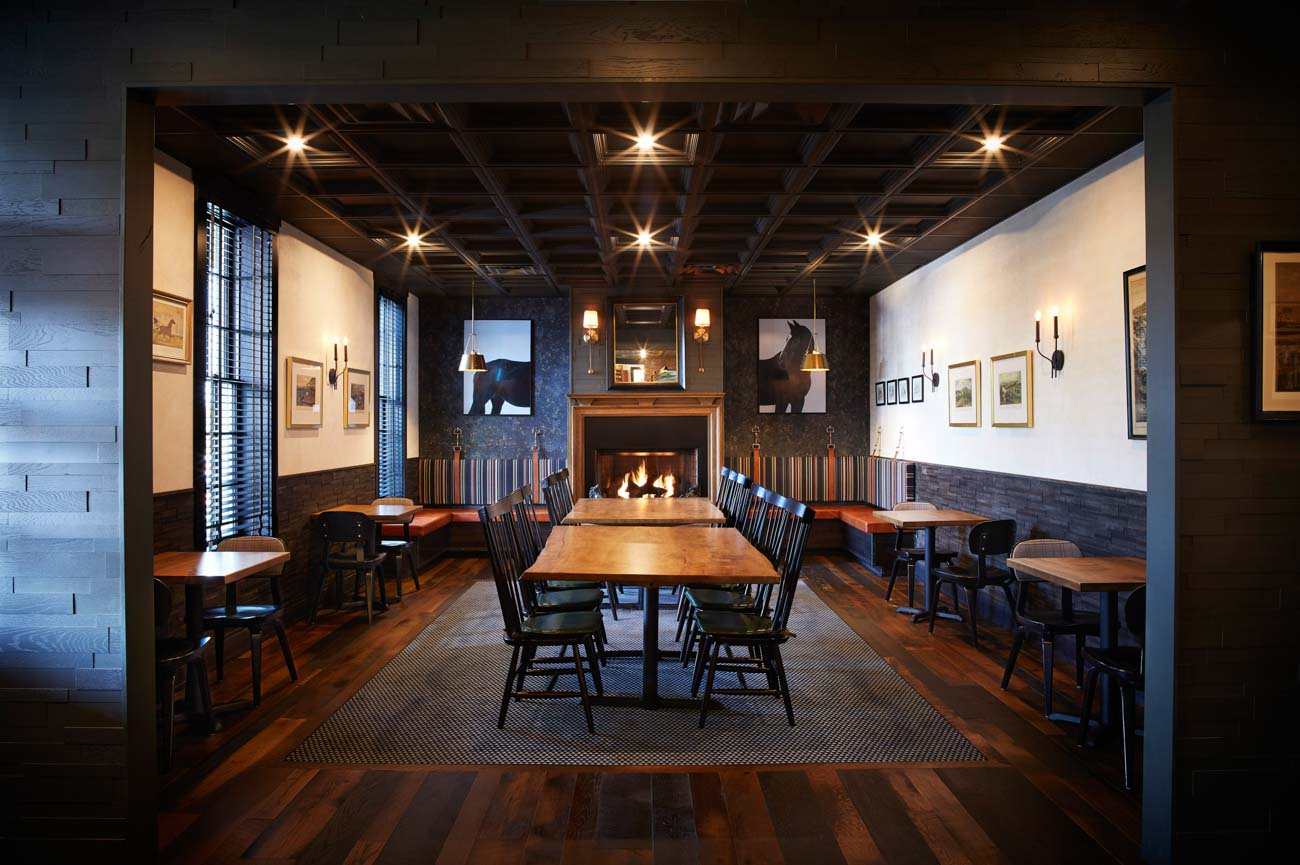 The Black Horse Tavern bar and dining room at The Golden Lamb received interior and graphic design work from Reztark. They revamped the space while preserving its historic integrity.  / Image courtesy of The Golden Lamb // Published: 10.16.20