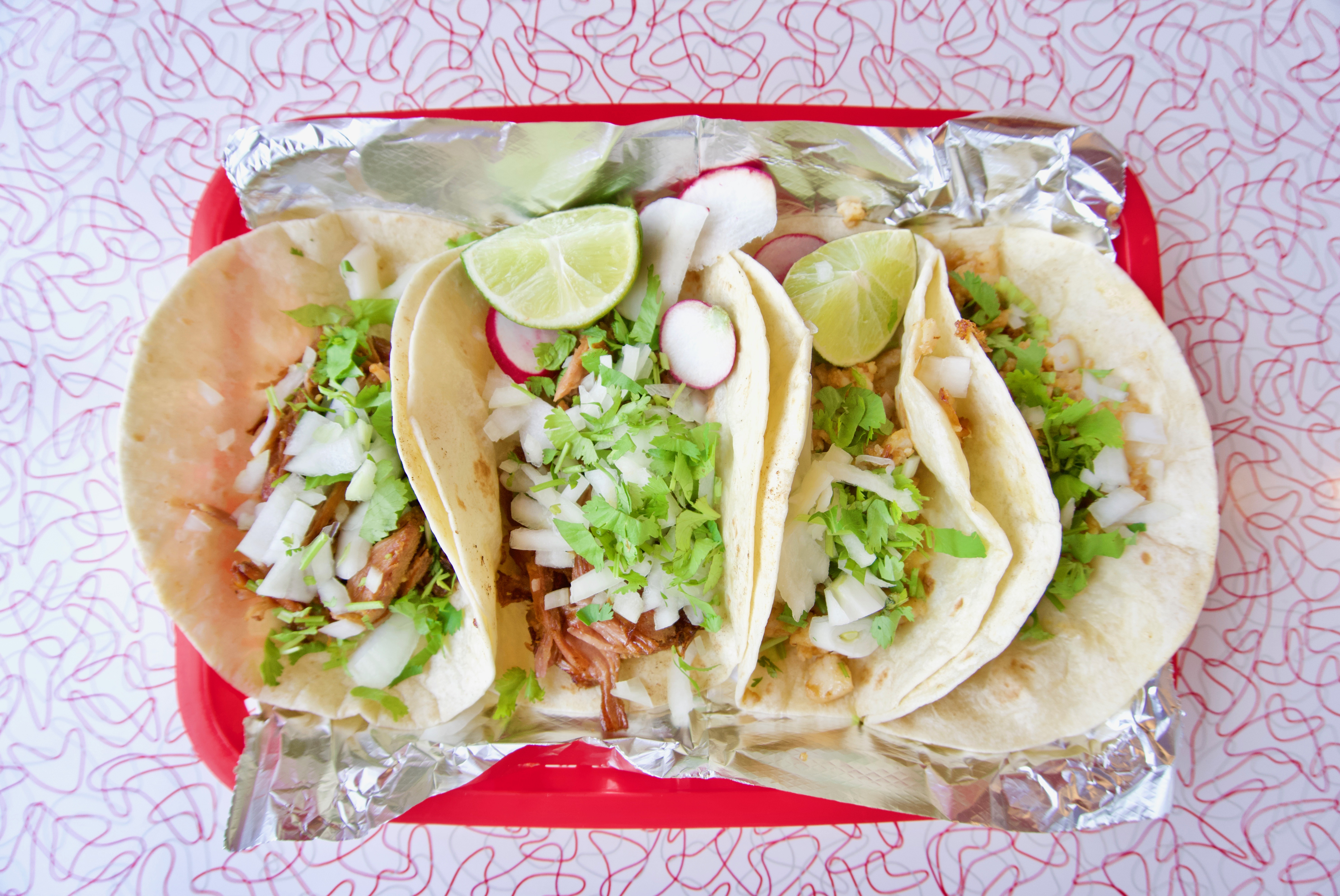 <p>Carnitas and pescado tacos / Image: Brian Planalp // Published: 5.20.18</p>