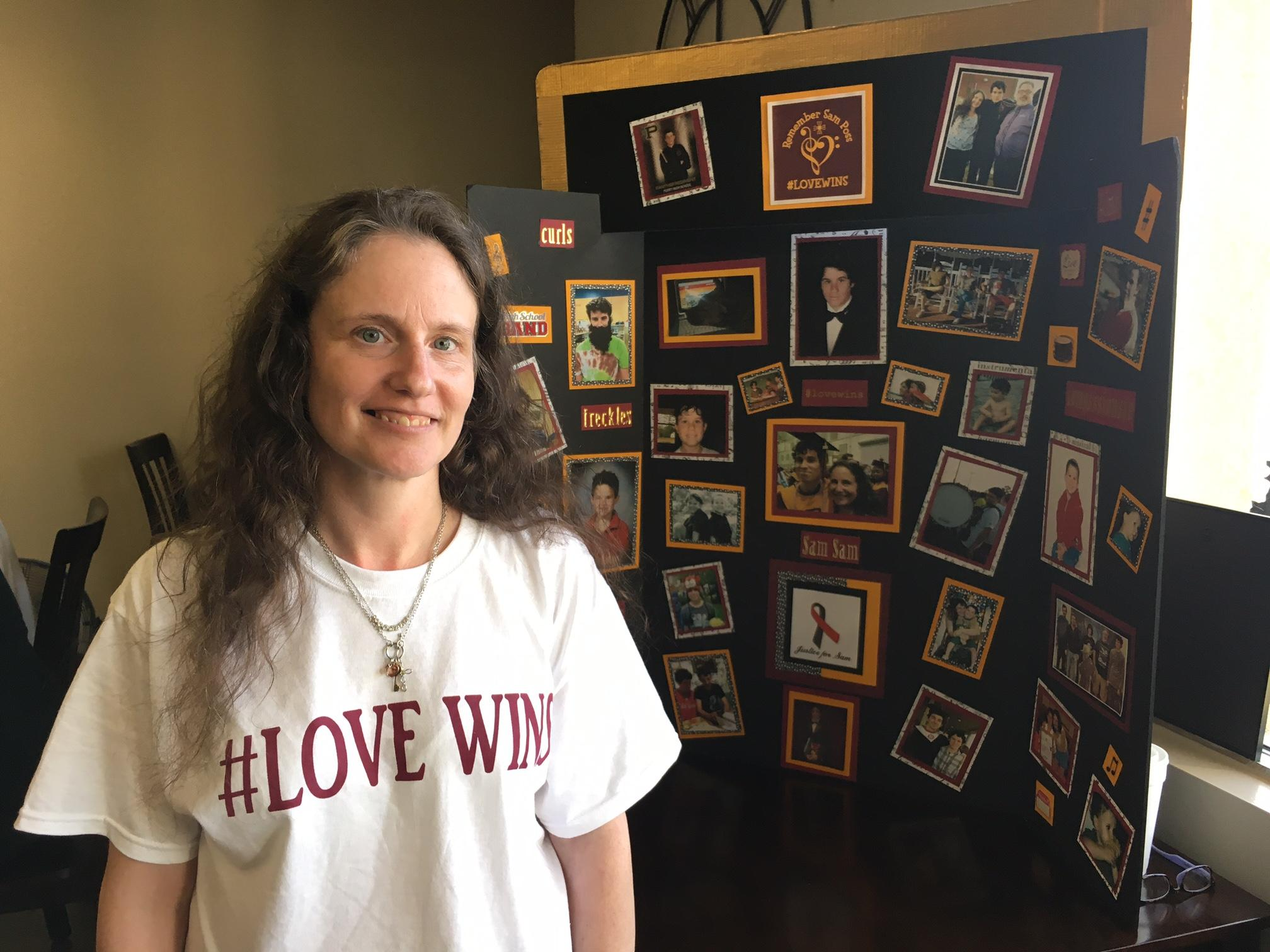 Sam Poss' Mother Nicole stands in front of a board with pictures of Sam at a benefit concert and BBQ in his honor. Eric Mock/WGXA