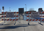 Main Street in downtown Green Bay is barricaded as the Ray Nitschke Memorial Bridge is raised for boat traffic Dec. 27, 2017.