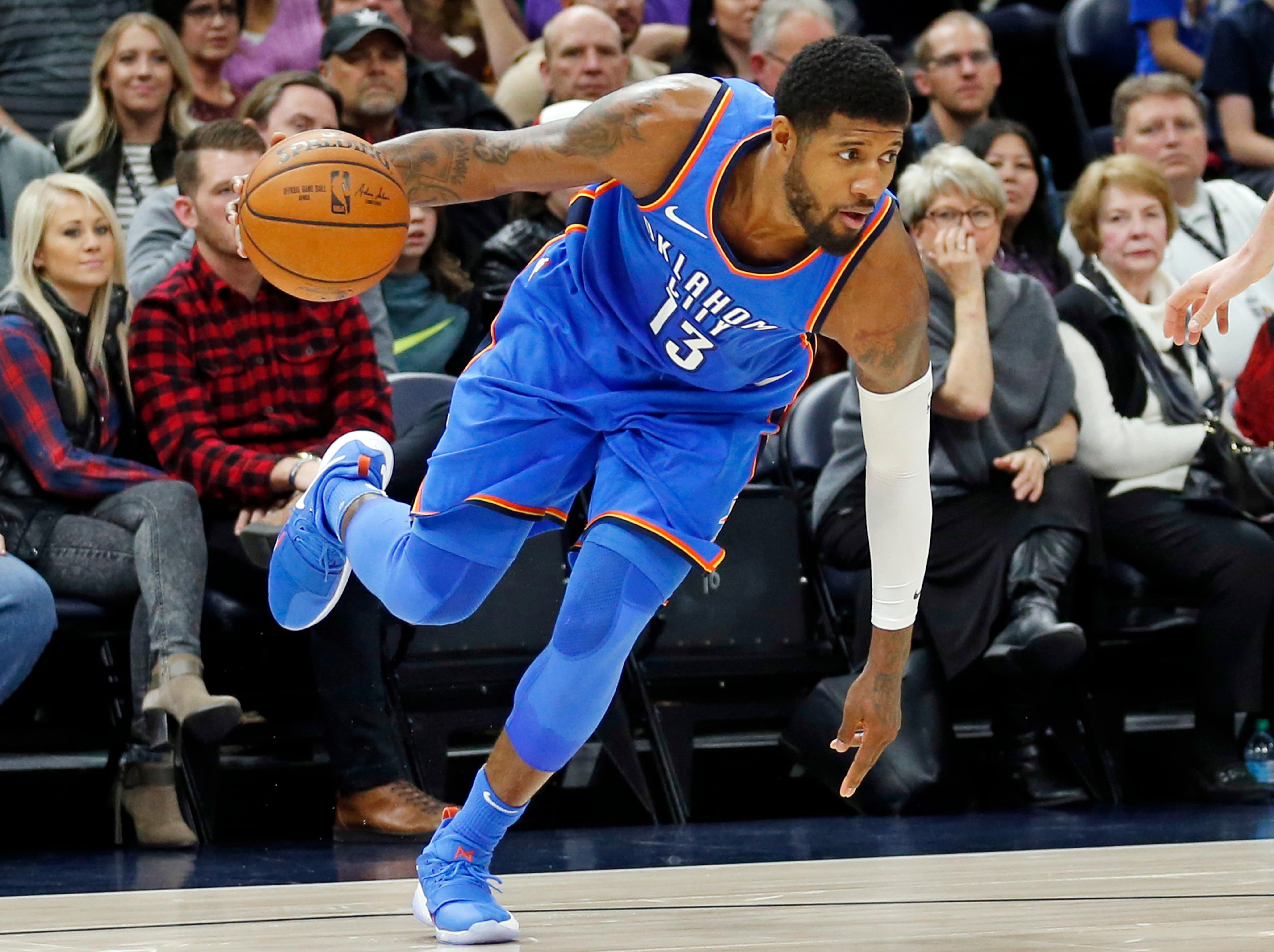 Oklahoma City Thunder forward Paul George (13) drives against the Utah Jazz in the first half during an NBA basketball game Saturday, Dec. 23, 2017, in Salt Lake City. (AP Photo/Rick Bowmer)