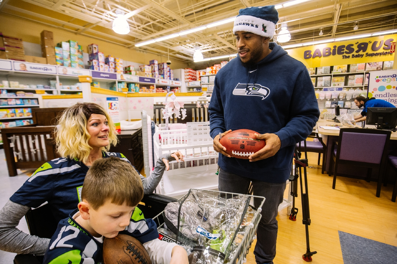 "Seattle Seahawks All Pro Linebacker Bobby Wagner surprised 50 South Park Community Center and Rotary Boys and Girls Club members with a shopping event at the Toys ""R"" Us in Bellevue, WA. Bobby invited a few teammates along to help kids shop, including Cliff Avril, KJ Wright, Brock Coyle and Mike Morgan. Bobby Wagner teamed up with Toys ""R""Us and Chick-Fil-A in Bellevue to provide this great experience for some deserving young 12's this holiday season. (Image: Joshua Lewis / Seattle Refined)"