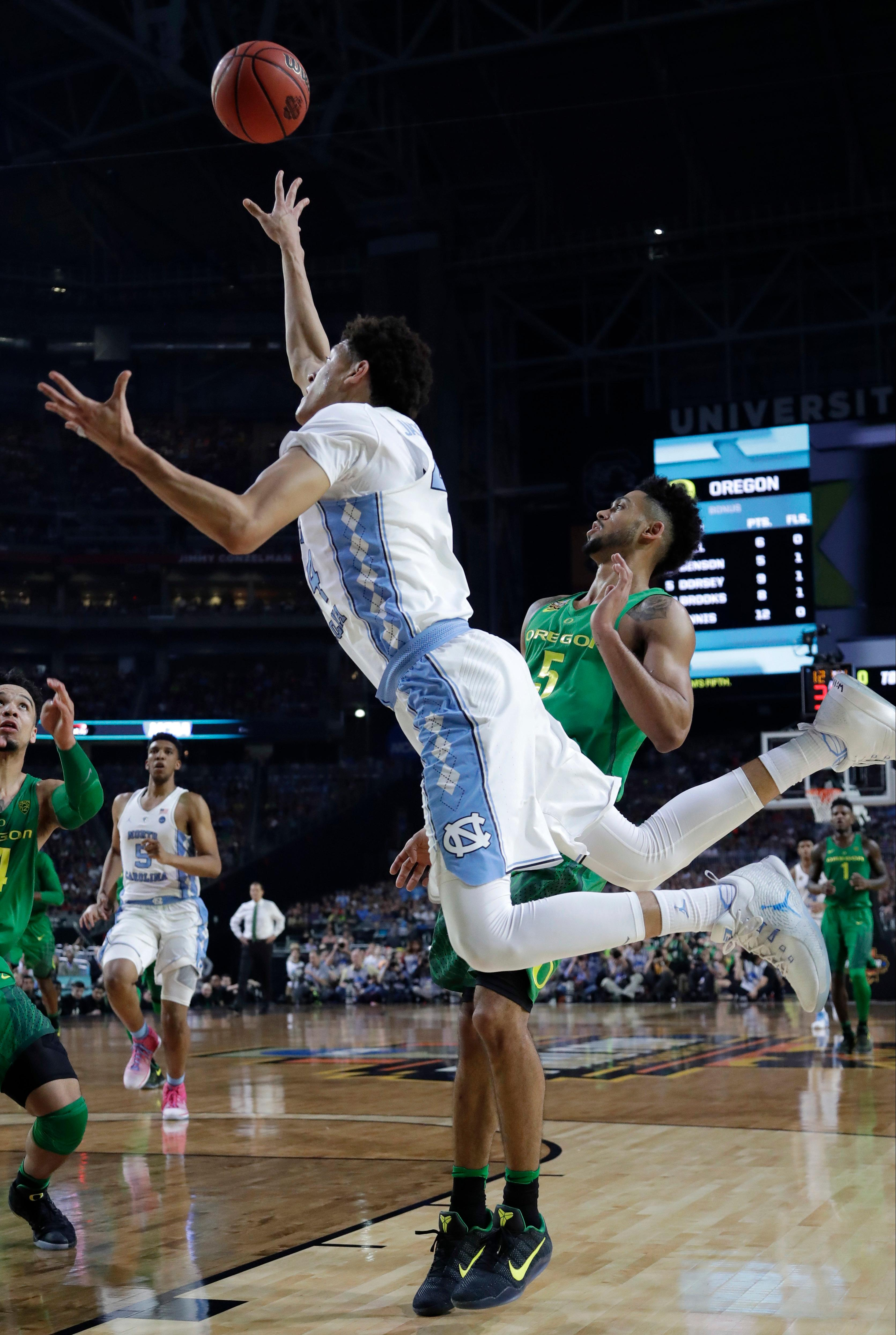 North Carolina forward Justin Jackson shoots over Oregon guard Tyler Dorsey, right, during the second half in the semifinals of the Final Four NCAA college basketball tournament, Saturday, April 1, 2017, in Glendale, Ariz. (AP Photo/David J. Phillip)