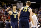 Michigan forward Moritz Wagner (13) and forward D.J. Wilson (5) celebrates a 73-69 win over Louisville in a second-round game in the NCAA tournament in Indianapolis, Sunday, March 19, 2017.