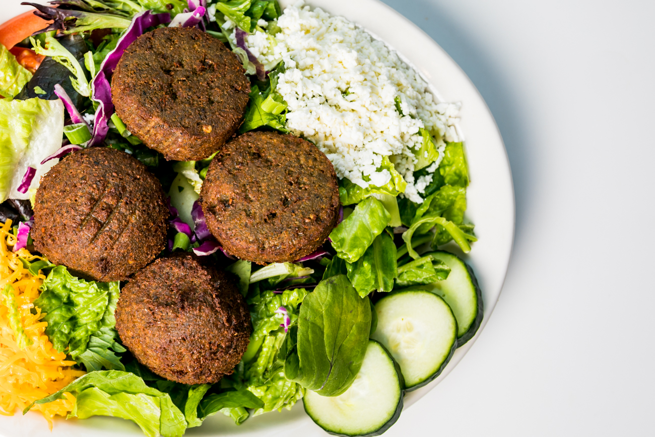 Falafel Salad: Crispy falafel patties over mixed greens, sliced cucumbers, tomatoes, and scallions served with tahini yogurt dressing and your choice of cheddar or feta cheese / Image: Amy Elisabeth Spasoff // Published: 7.19.18