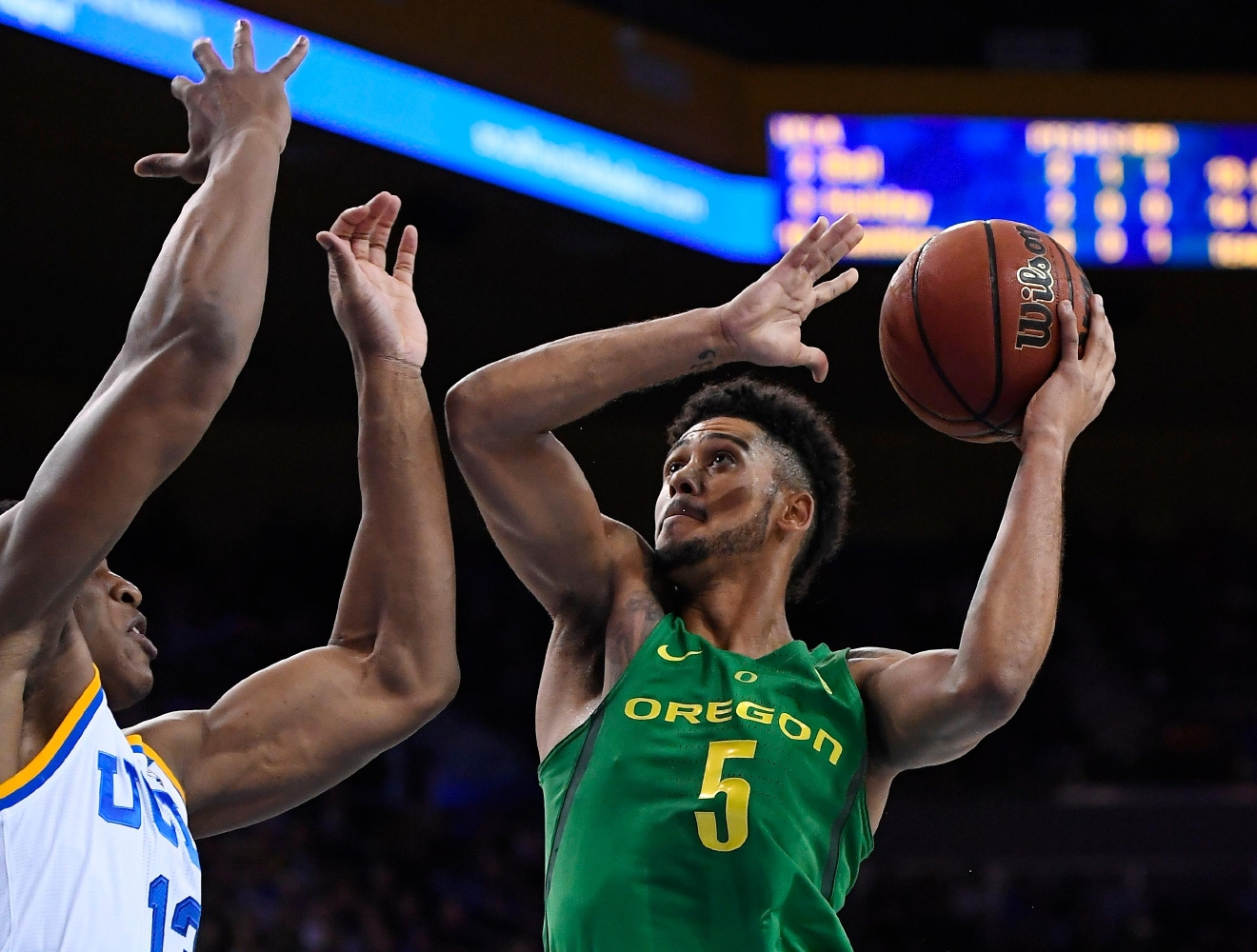 Oregon guard Tyler Dorsey, right, shoots as UCLA forward Ike Anigbogu defends during the first half of an NCAA college basketball game, Thursday, Feb. 9, 2017, in Los Angeles. (AP Photo/Mark J. Terrill)
