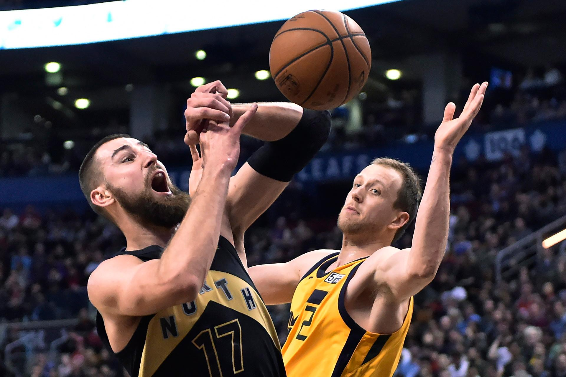 Toronto Raptors center Jonas Valanciunas (17) is fouled by Utah Jazz forward Joe Ingles (2) during the second half of an NBA basketball game Friday, Jan. 26, 2018, in Toronto. (Frank Gunn/The Canadian Press via AP)