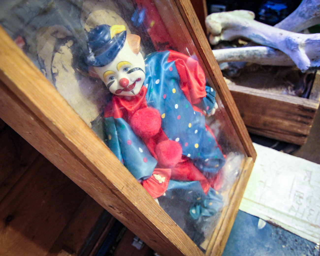 "#6 - ""The Cracking Man,"" a clown doll that is believed to have manifested a twisted, broken man who appears at people's bedsides at night. Read more about The Cracking Man in the story. / Image courtesy of Greg Newkirk // Published: 10.20.17<p></p>"