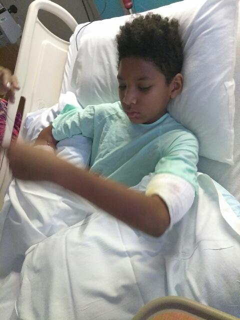 Mother: boy's life was saved by mauling dogs' owner. (WPEC)