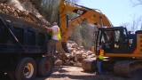 DOT crews hauling away debris from Old Marshall Highway rockslide
