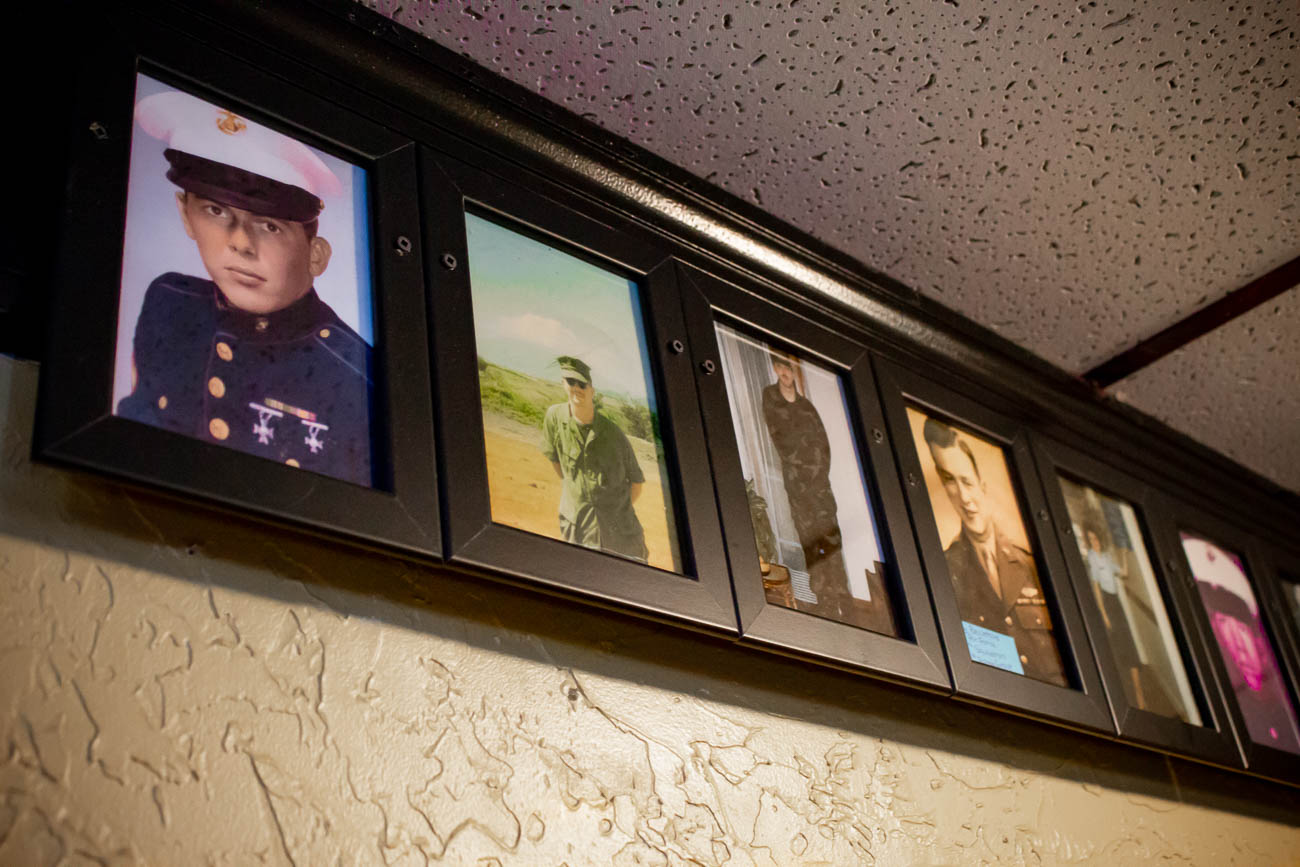 You'll see pictures of U.S. soldiers along the walls, some of whom feature current bar patrons of PeeWee's. / Image: Katie Robinson, Cincinnati Refined // Published: 10.15.18