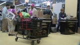 Shoppers pick up last minute grocery items the day before Thanksgiving