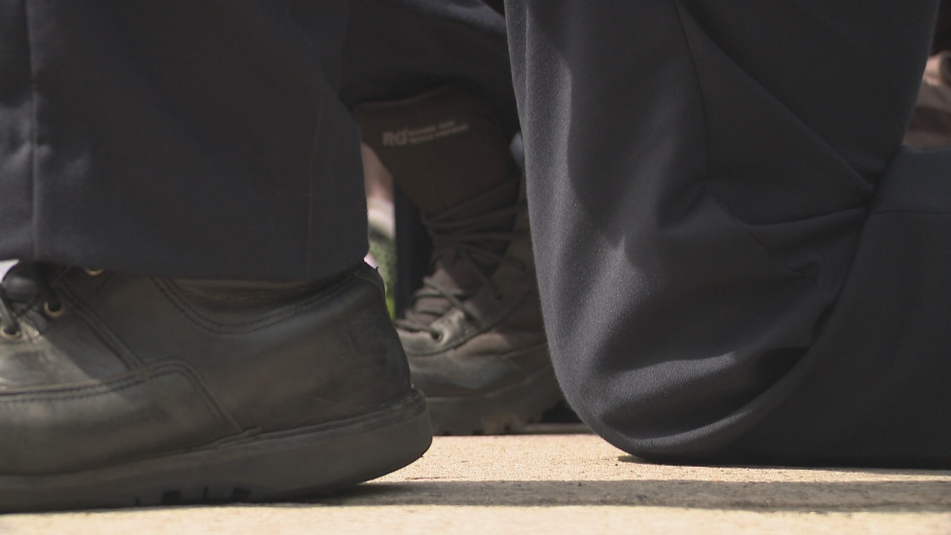 Grand Rapids police and Kent County deputies kneeled and chanted with protesters on June 3, 2020.{ } (WWMT/Jason Heeres)