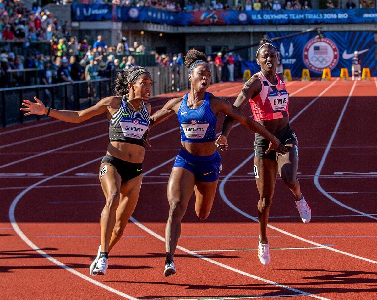 Left to right: Nike's English Gardner, Nike's Tianna Bartoletta, and Adidas' Tori Bowie finish first second and third in the 100 meter final. All three will be headed to Rio to fight for gold. Photo by August Frank, Oregon News Lab