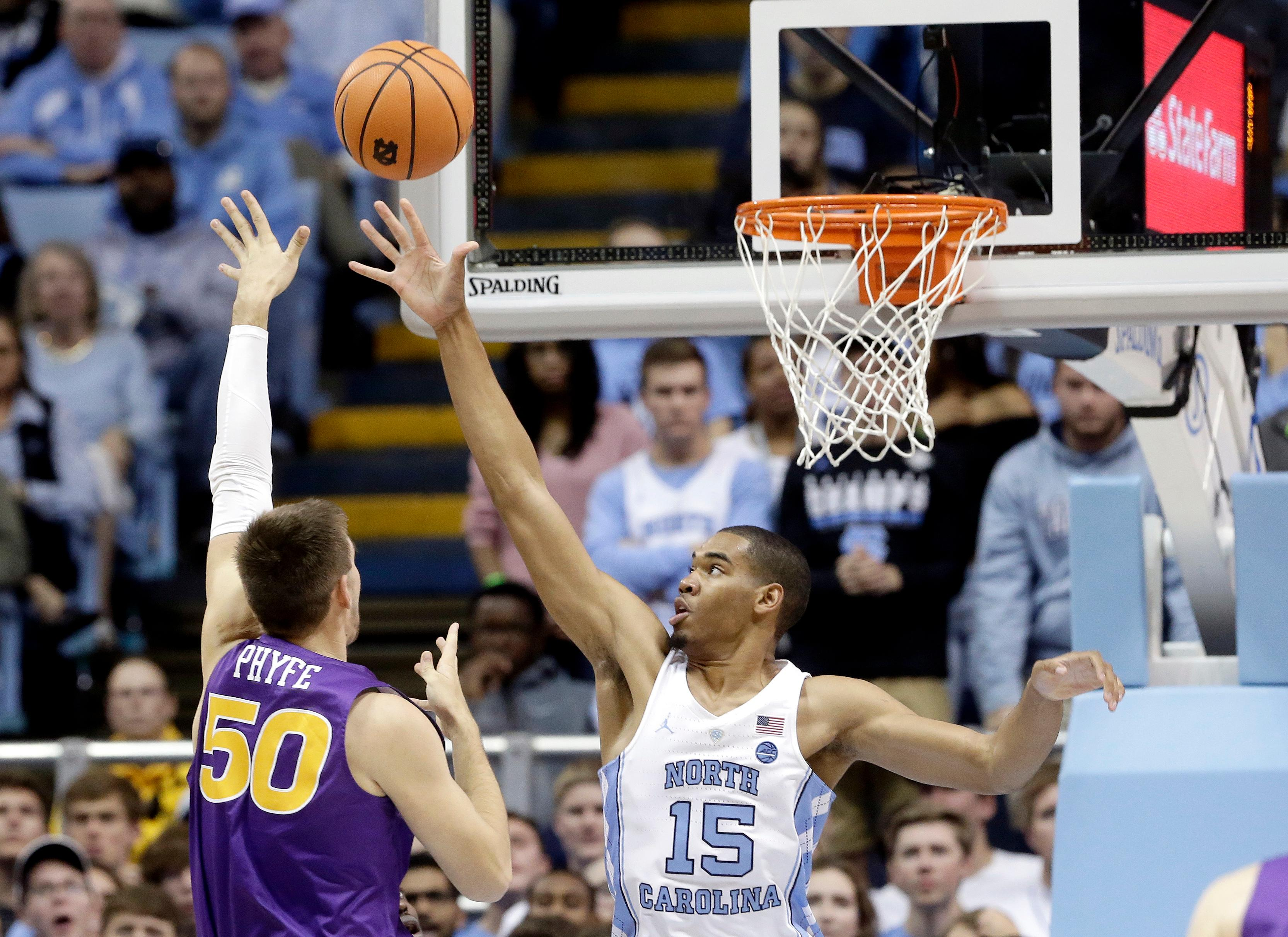 North Carolina's Garrison Brooks (15) defends while Northern Iowa's Austin Phyfe (50) shoots during the first half of an NCAA college basketball game in Chapel Hill, N.C., Friday, Nov. 10, 2017. (AP Photo/Gerry Broome)