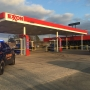Armed robbery at Exxon gas station, officers looking for suspects