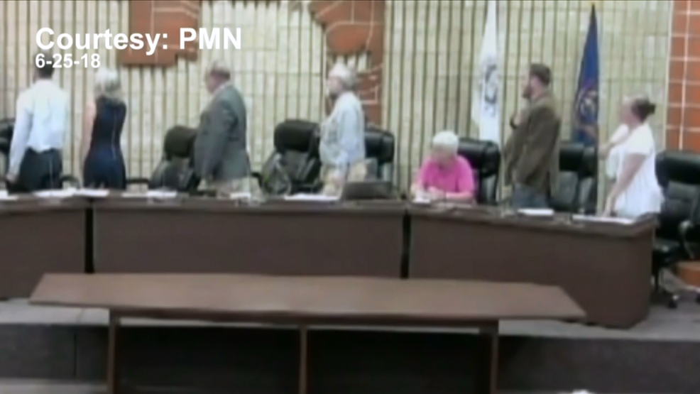 Kalamazoo Township Trustee sits during Pledge of Allegiance in protest | WWMT