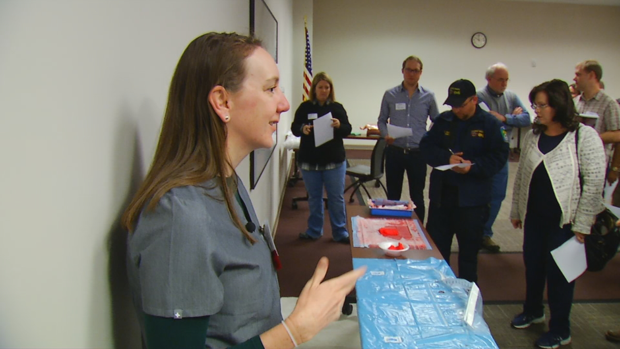 Everyone from nurses to paramedics to doctors -- who don't often encounter delivery -- engaged in various simulations during Basic Life Support in Obstetrics training at MAHEC in Asheville. (Photo credit: WLOS staff)