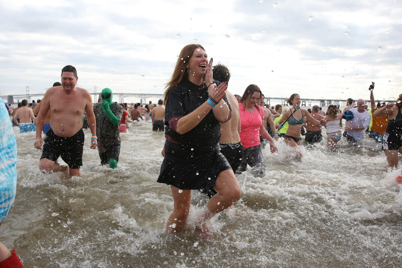 As many as 10,000 people braved the wintry Chesapeake  Bay for the 21st annual Polar Bear Plunge. The multi-day event raises money for Special Olympics, but participants retain bragging rights. (Amanda Andrade-Rhoades/DC Refined)