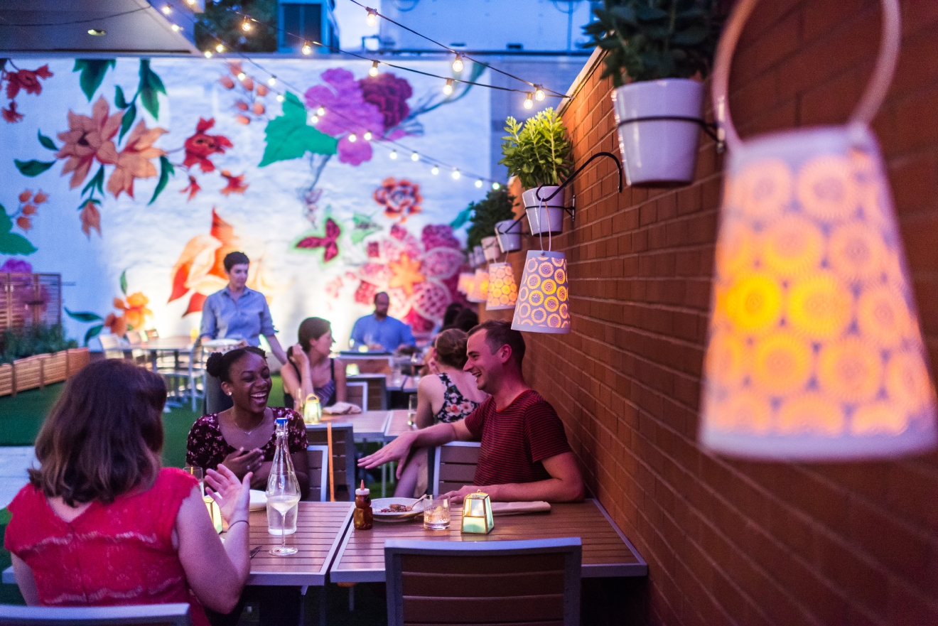 Hazel has one of the prettiest patios in D.C. and they're officially open for the season! While you're there, check out their new happy hour menu. (Image: Rey Lopez)