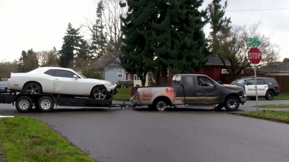 Police Pickup Hauling Stolen Car Hits Several Vehicles During - Stolen car