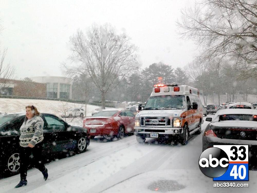 An ambulance attempts to pass vehicles on a snowy, icy Riverchase Parkway, Tuesday, January 28, 2014.