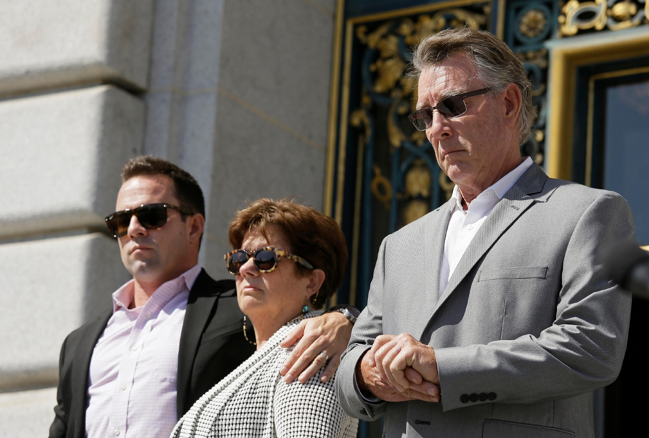 File - In this Sept. 1, 2015 file photo, from left, Brad Steinle, Liz Sullivan and Jim Steinle, the brother, mother and father of Kathryn Steinle who was shot to death on a pier, listen to their attorneys speak during a news conference on the steps of City Hall in San Francisco.{&amp;nbsp;} (AP Photo/Eric Risberg, File)<p></p>