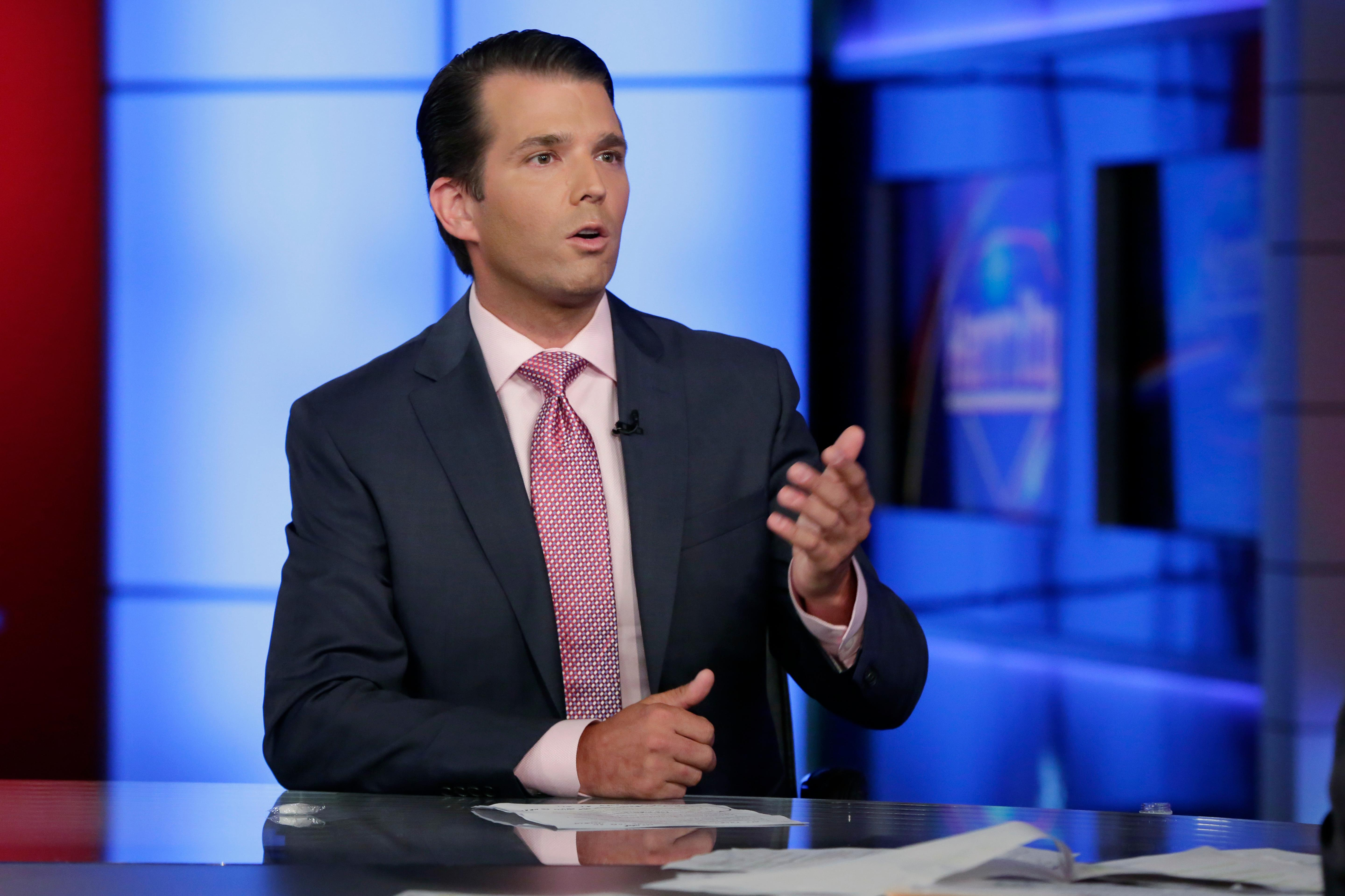 Donald Trump Jr. is interviewed by host Sean Hannity on his Fox News Channel television program, in New York Tuesday, July 11, 2017. Donald Trump Jr. has long been his father's id, the brawler who has helped fuel the president's pugilistic instincts and stood firm as one of his fiercest defenders. Now the president's eldest son is at the center of the firestorm over Russian connections swirling around his father's administration and trying to fight off charges that he was open to colluding with Moscow to defeat Hillary Clinton. (AP Photo/Richard Drew)