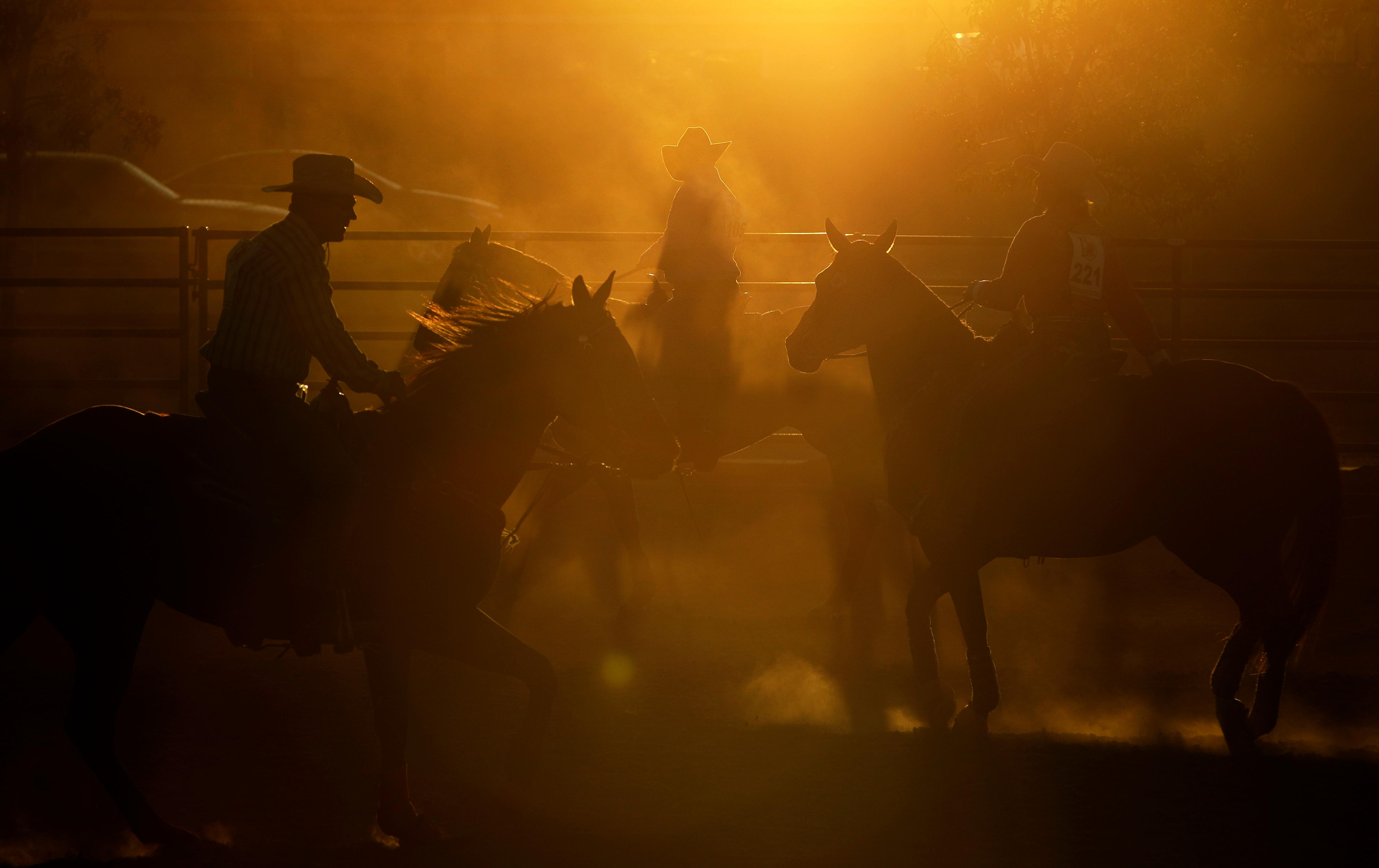 In this Sept. 23, 2017, photo, competitors ride horses in a warm-up area before competing in the Bighorn Rodeo in Las Vegas. The drew more than 200 spectators and 73 participants from across the U.S. The circuit's finals are taking place this weekend in Albuquerque, New Mexico.  (AP Photo/John Locher)